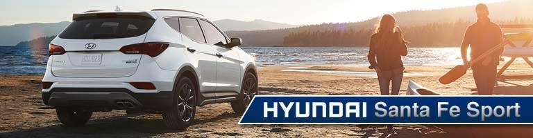 white Hyundai Santa Fe Sport parked on beach