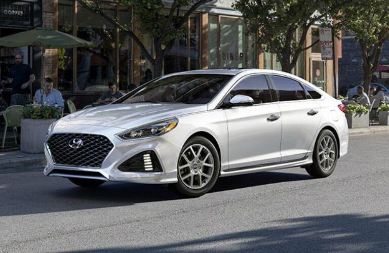 Silver 2018 Hyundai Sonata parked on city street