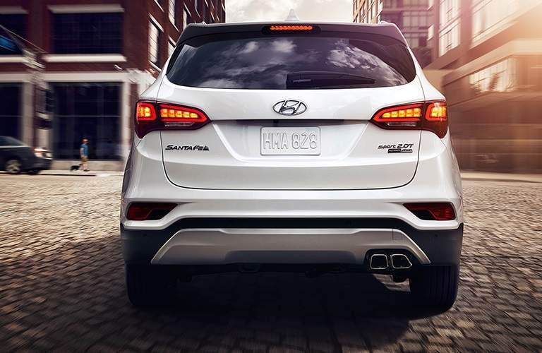 Rear view of a white 2018 Hyundai Santa Fe Sport