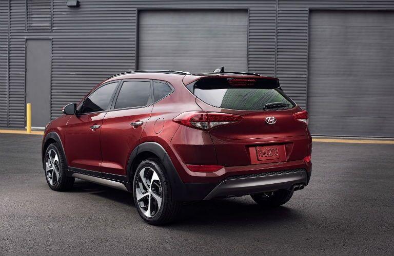 red 2018 Hyundai Tucson parked by garage