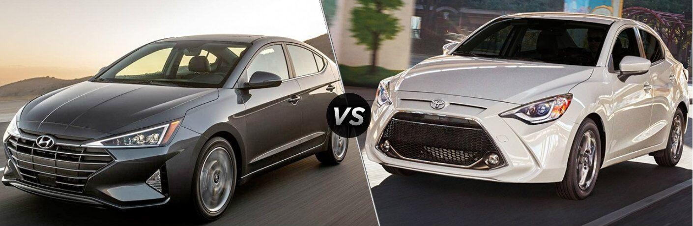 Gray 2019 Hyundai Elantra and white 2019 Toyota Yaris side by side