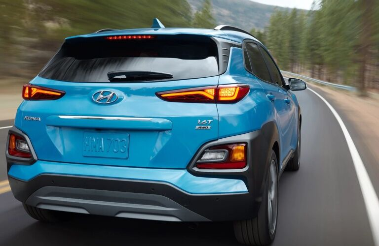 Rear view of a blue 2019 Hyundai Kona