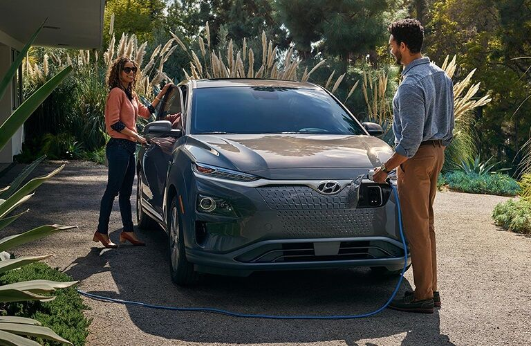 Man charging the 2019 Hyundai Kona