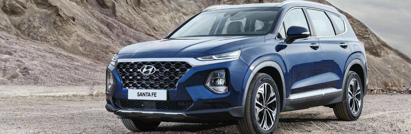 Blue 2019 Hyundai Santa Fe parked on side of the road