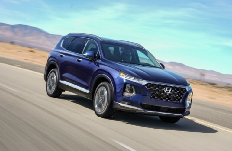 Blue 2019 Hyundai Santa Fe driving on open road