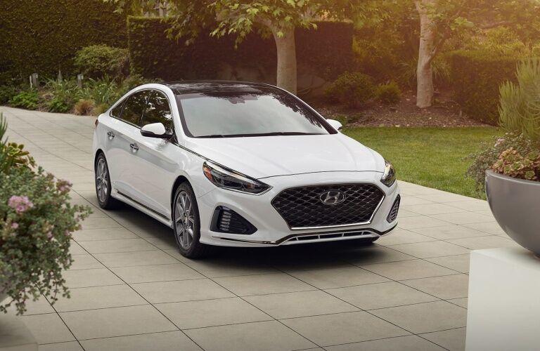 White 2019 Hyundai Sonata parked in driveway
