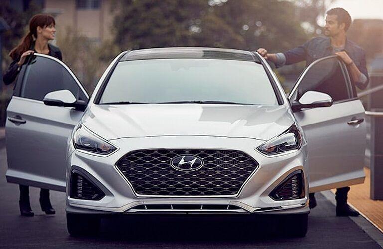 Man and woman stepping inside the 2019 Hyundai Sonata