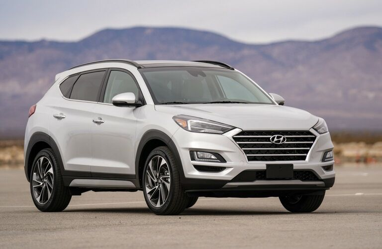 White 2019 Hyundai Tucson in front of mountains
