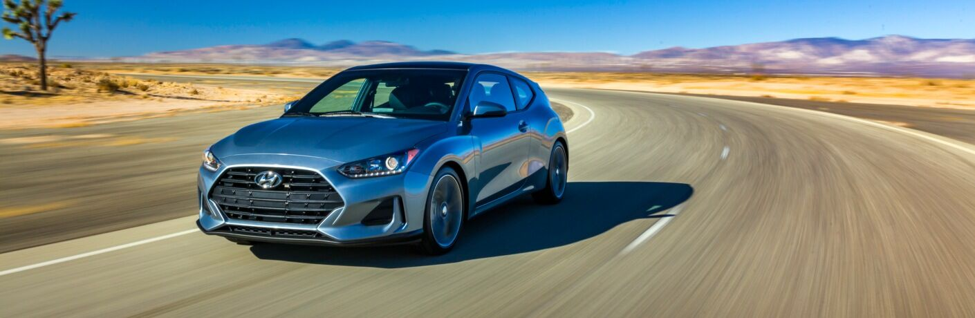2019 Hyundai Veloster driving on open desert road