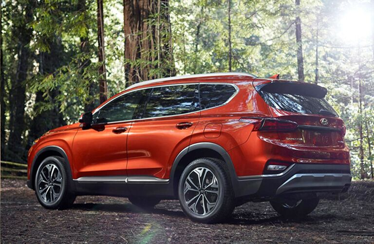 2020 Nissan Rogue parked in woods under tree