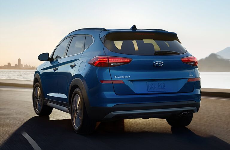 2020 Hyundai Tucson driving away on road next to water