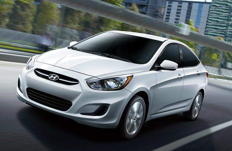 White 2017 Hyundai Accent driving on city street