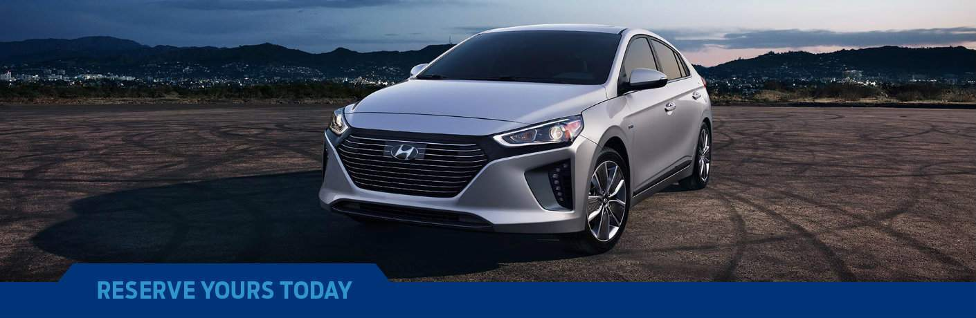 2018 Hyundai Ioniq on city backdrop with Reserve Yours Today text