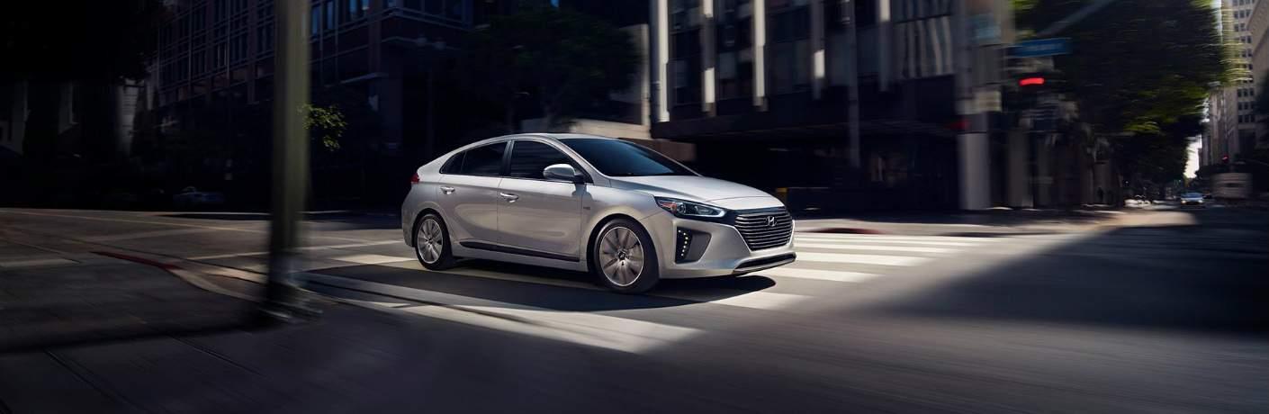 silver 2018 Hyundai Ioniq driving through city