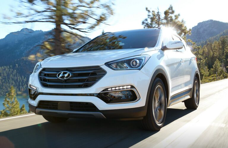 White 2017 Hyundai Santa Fe Sport driving near water body