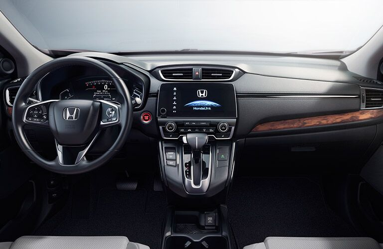 steering wheel and dashboard view of the 2017 Honda CR-V