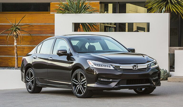 2017 Honda Accord parked in front of a home