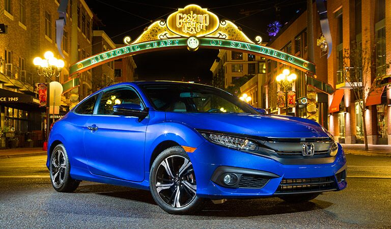 blue 2017 Honda Civic parked stylishly in the middle of a city street