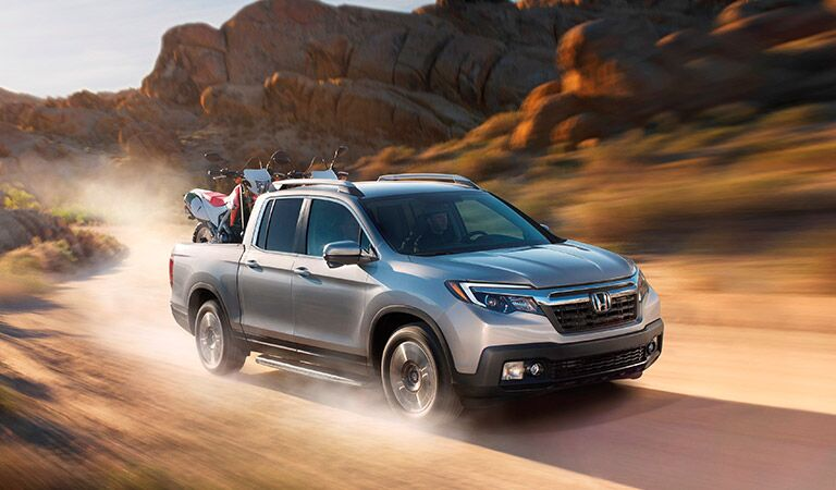 2017 Honda Ridgeline driving on a dirt road