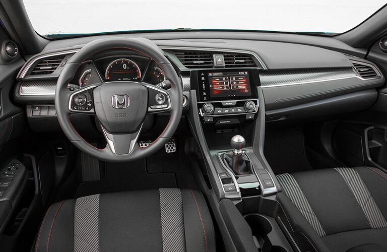 steering wheel and dashboard of the 2018 Honda Civic Si