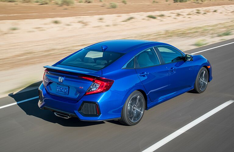 slightly overhead view of a blue 2018 Honda Civic Si driving in the desert