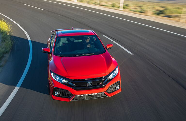 front and slightly overhead view of a red 2018 Honda Civic Si on the track