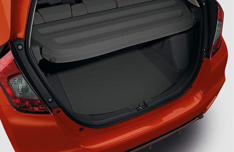 rear cargo area of a red 2018 Honda Fit