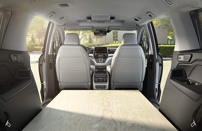 rear cargo area of the 2018 Honda Odyssey EX with a board where the seats are usually