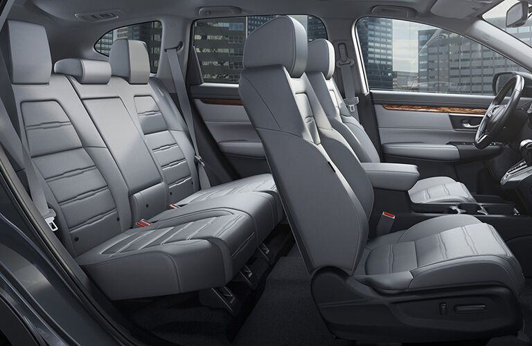 2019 Honda CR-V interior side view of front and rear seats with city in background