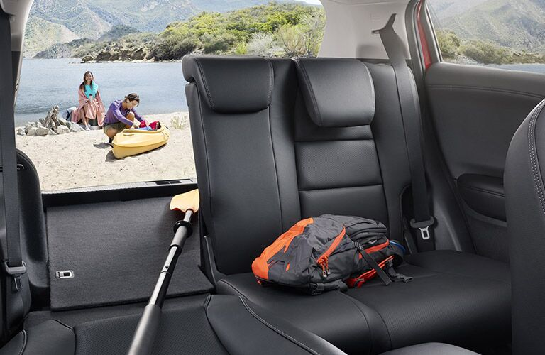 2019 Honda HR-V interior back cabin seats  half folded down with people standing outside on beach