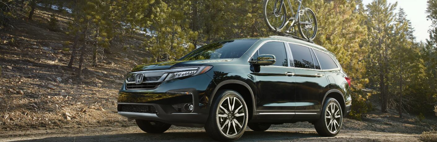 2019 Honda Pilot driving in the forest