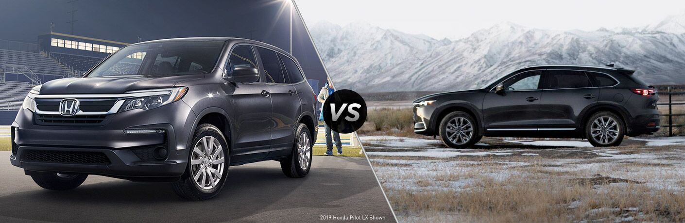 2019 Honda Pilot exterior front fascia and driver side parked in empty stadium with man walking towards back vs 2019 Mazda CX-9 exterior driver side profile parked in empty valley with mountains in background
