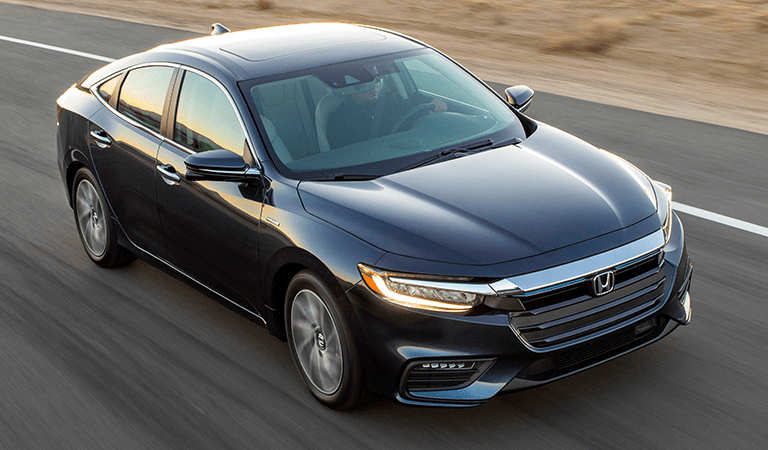 2018 Honda Insight exterior front fascia and passenger side top view going fast on blurred highway