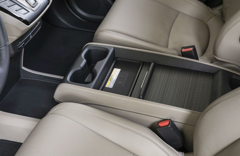 2019 Honda Odyssey interior front cabin close up of center console and partial seats