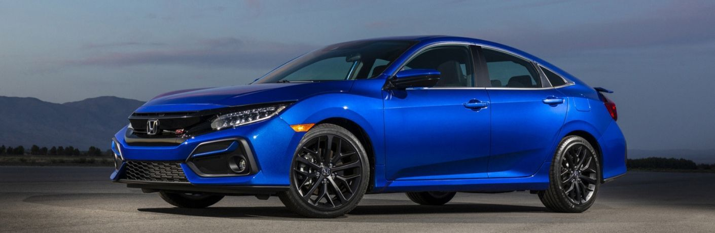 2020 Honda Civic Si sedan exterior front fascia and driver side in empty lot with mountains in background