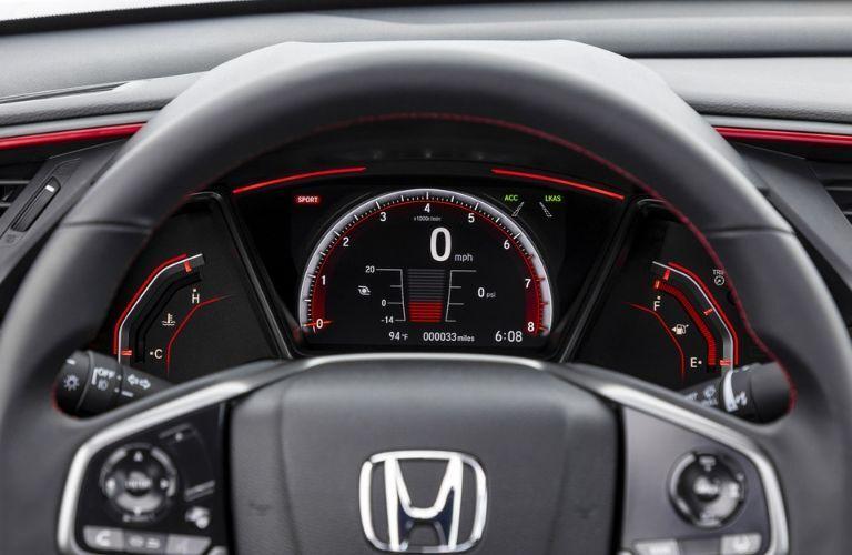 2020 Honda Civic Si sedan interior looking past steering wheel to digital instrument cluster