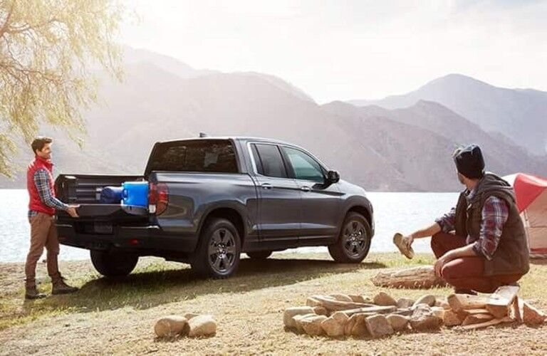 Two men around tailgate of 2020 Honda Ridgeline