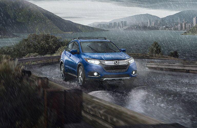 Blue 2021 Honda HR-V driving through rain