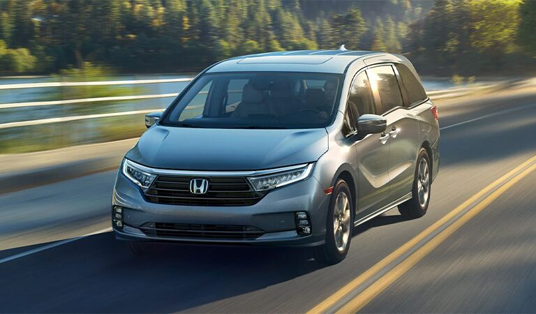2018 Honda Odyssey exterior front fascia and passenger side going fast on blurred highway