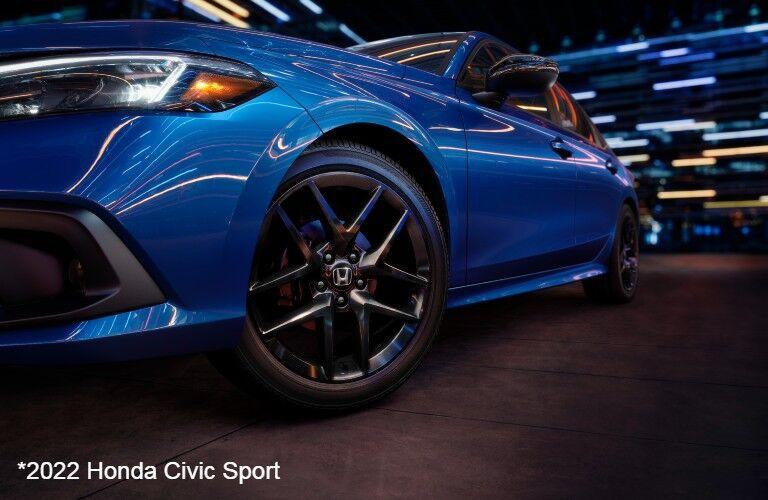 Closeup of wheel on blue 2022 Honda Civic Sport