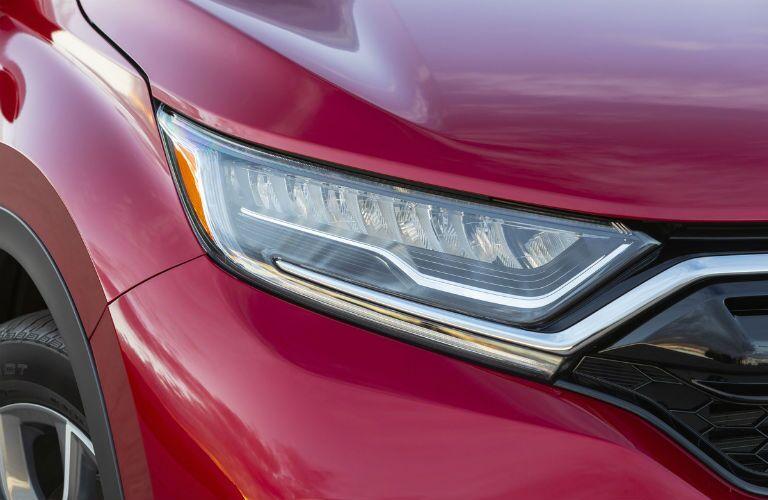 Closeup of headlight on red 2020 Honda CR-V Hybrid
