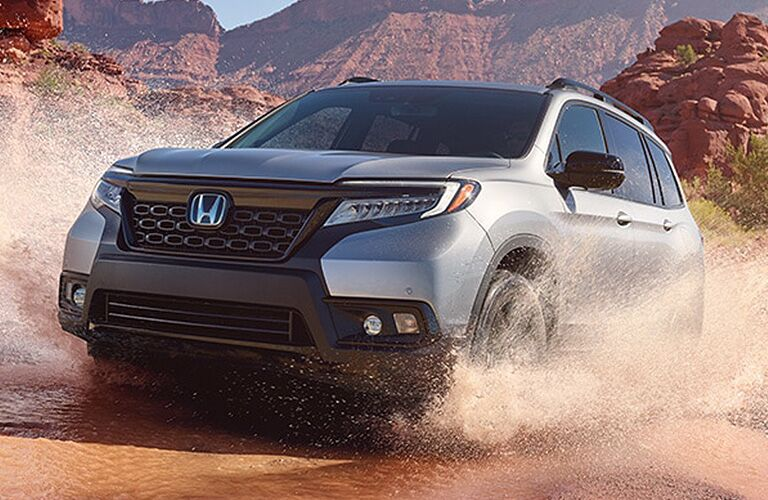 2018 Honda Passport exterior front fascia and driver side splashing through puddle off road