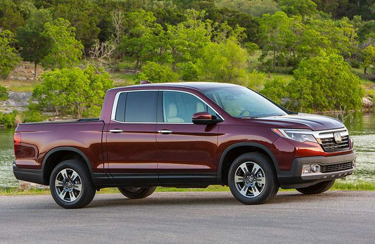 side view of a deep red 2018 Honda Ridgeline