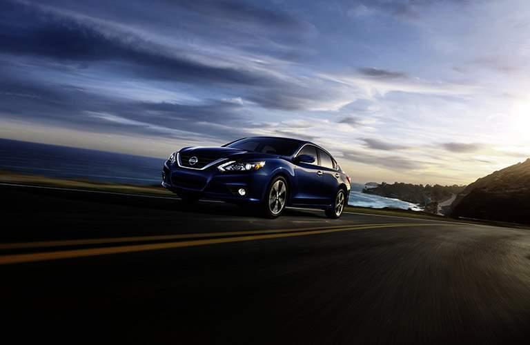 2017 Nissan Altima driving along coast at twilight