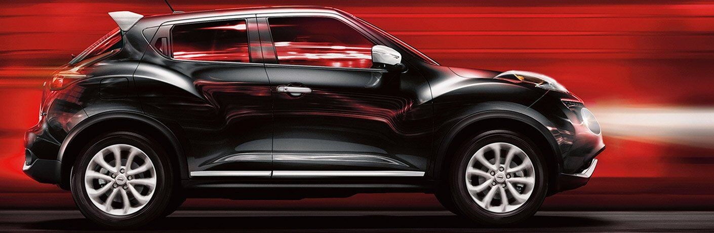 black 2017 Nissan Juke exterior side surrounded by red light