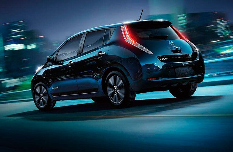 2017 Nissan Leaf driving down highway at night exterior rear view