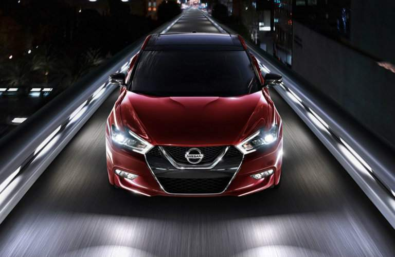 red 2017 Nissan Maxima exterior front view as it drives over bridge