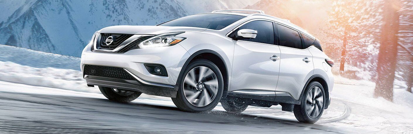 white 2017 Nissan Murano driving on snowy road
