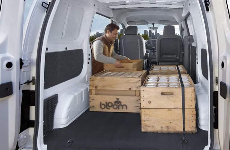 man unloading cargo from 2017 Nissan NV200 Compact Cargo van