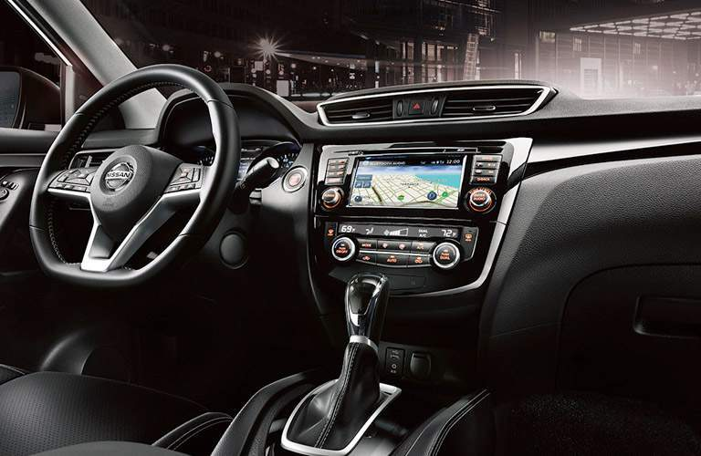 2017 Nissan Rogue Sport interior steering wheel and dashboard